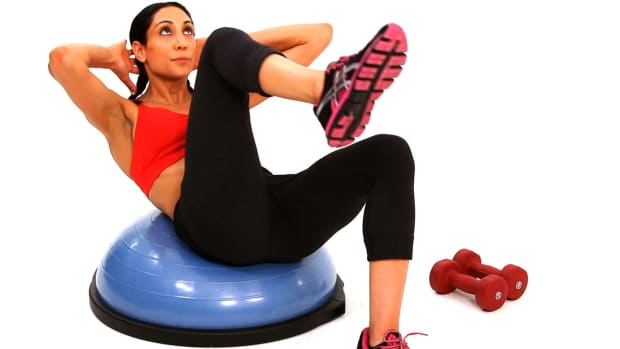 K. How to Do a Bicycle Crunch with a Bosu Ball Promo Image