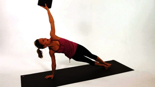 P. How to Do a Side Plank Yoga Pose (Vasisthasana) Promo Image