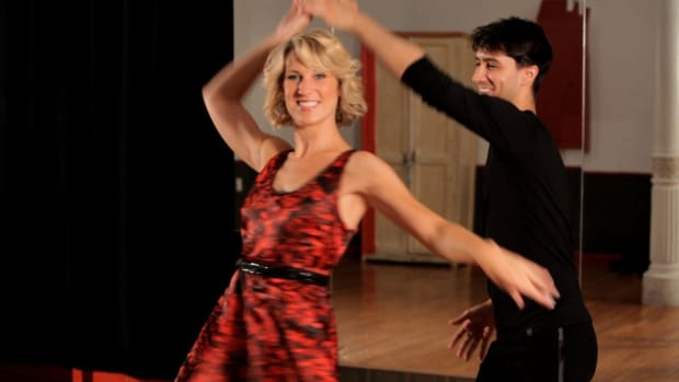 B. How to Do a Ladies Underarm Turn in Swing Dance Promo Image