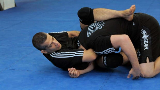 ZZA. How to Do a Rolling Sleeper Guillotine MMA Submission Promo Image