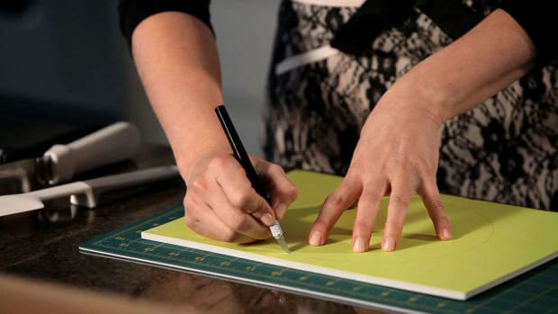 A. How to Cut a Cake Tier Board for a Wedding Cake Promo Image