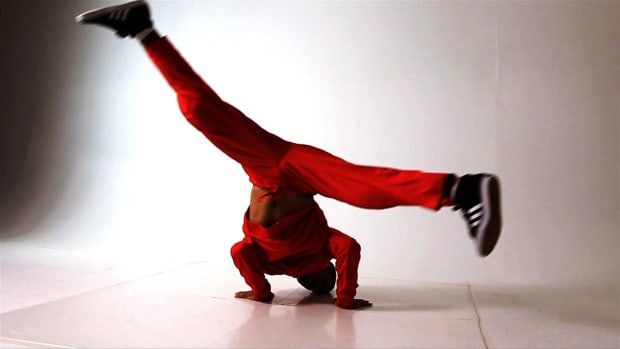 A. How to Do a Windmill to a Back Spin Break Dancing Move Promo Image