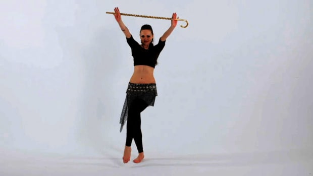 J. How to Use a Cane in Belly Dancing Promo Image