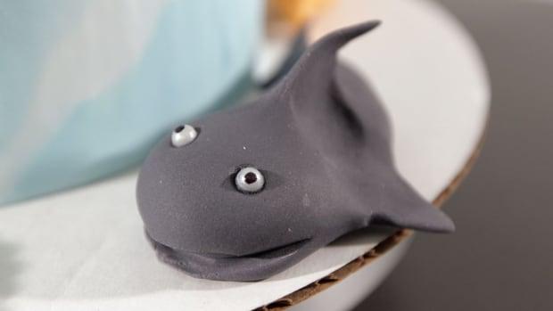 O. How to Make a Fondant Shark for a Beach Theme Cake Promo Image