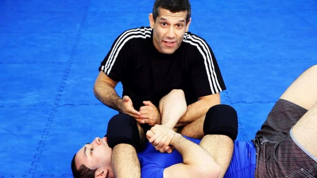 ZZG. How to Do the Finishing the Arm Bar MMA Technique Promo Image