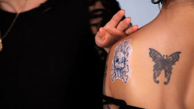 D. How to Apply an Alcohol Transfer Fake Tattoo Promo Image