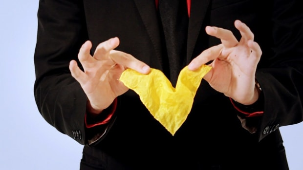 ZH. How to Do the Disappearing Handkerchief Magic Trick Promo Image