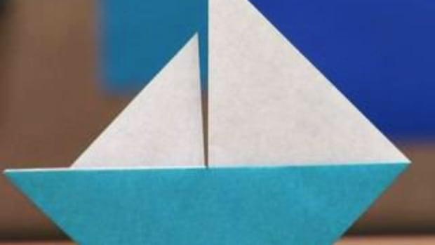 E. How to Fold an Origami Sailboat Promo Image