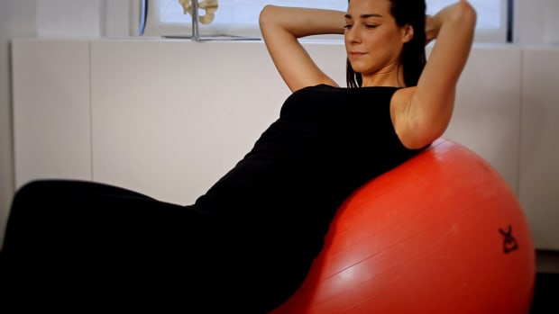D. How to Do an Exercise Ball Crunch for Back Pain Relief Promo Image