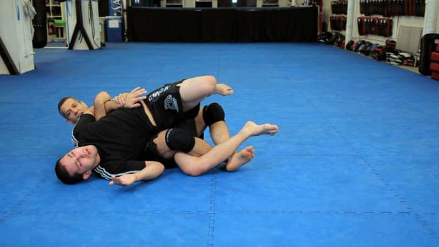 ZZD. How to Do a Twister Lock MMA Submission Promo Image