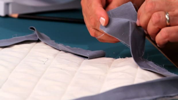ZE. How to Finish a Continuous Binding Strip on a Quilt Promo Image