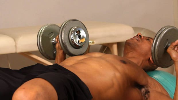 M. How to Do an Exercise Ball Dumbbell Press Promo Image