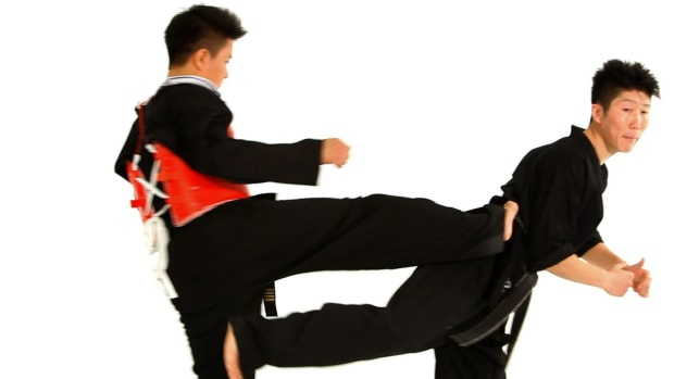 X. How to Do a Jump Back Kick in Taekwondo Sparring Promo Image