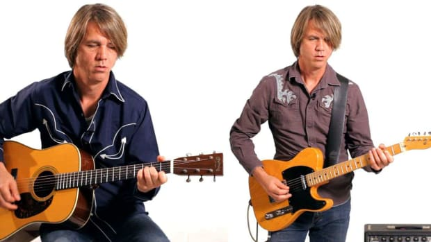 B. Electric vs. Acoustic Guitar in Country Music Promo Image