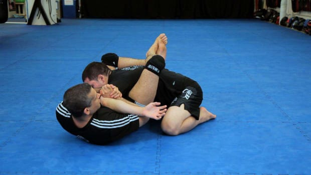 Q. How to Do a Kimura from Triangle Choke Hold MMA Submission Promo Image