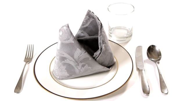ZL. How to Fold a Napkin into a Bishop's Mitre Promo Image