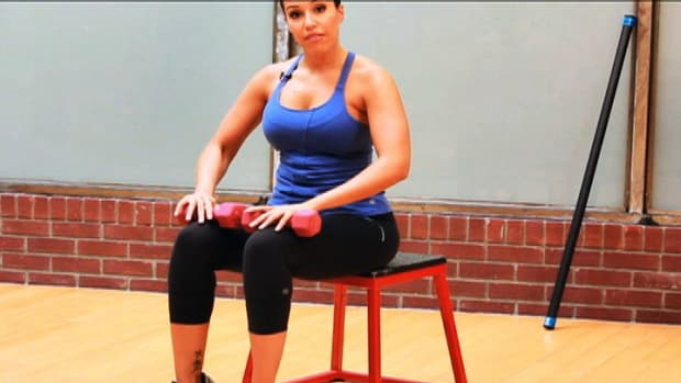 ZU. How to Do a Seated Calf Raise for a Female Leg Workout Promo Image
