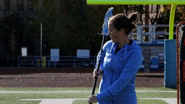 ZD. How to Do a Behind-the-Back Pass in Women's Lacrosse Promo Image