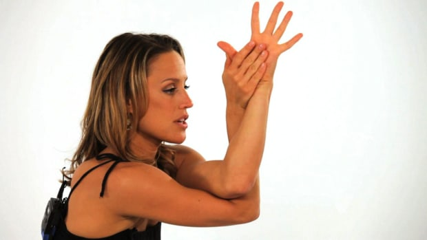 ZE. How to Do an Eagle Yoga Pose (Garudasana) Promo Image
