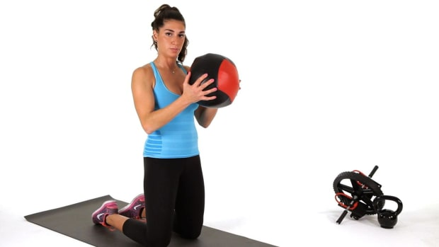 X. How to Do a Kneeling Chop Exercise with a Medicine Ball Promo Image
