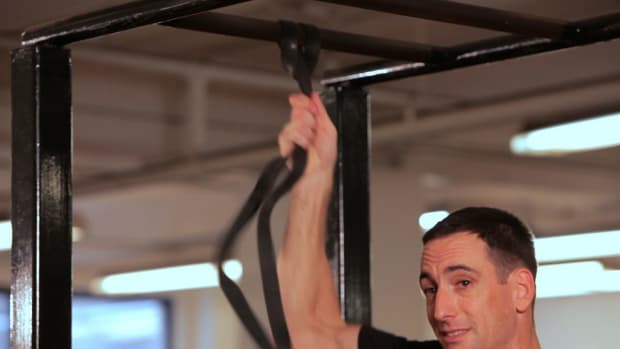 ZA. How to Do an Assisted Pull-Up Promo Image