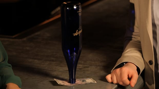 Y. How to Pull a Dollar out from under a Beer Bottle Promo Image
