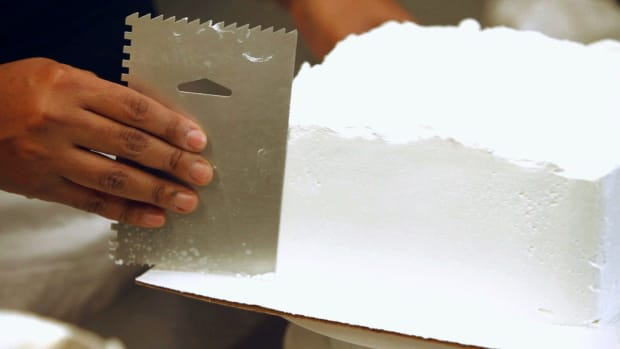 Q. How to Frost the First Layer of a Princess Castle Cake Promo Image