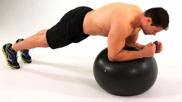 Z. How to Do a Front Plank on an Exercise Ball Promo Image