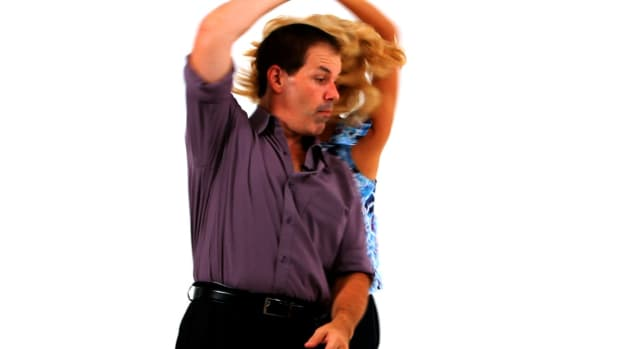 Q. How to Do an East Coast Swing Barrel Roll in Swing Dance Promo Image