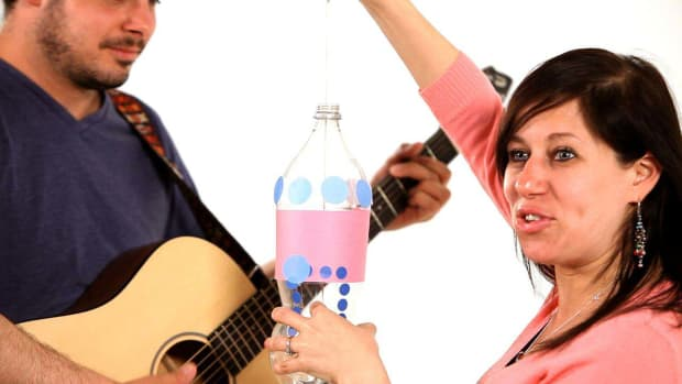 K. How to Add Strings to a Bass Made from a Soda Bottle Promo Image