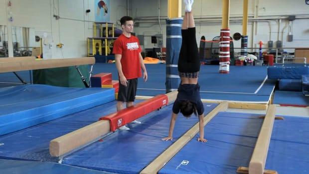 ZA. Back Walkover on Balance Beam Drills Promo Image