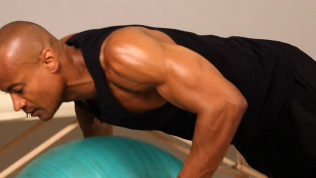 E. How to Do an Exercise Ball Push-Up Promo Image