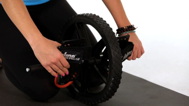 U. How to Do Kneeling Ab Wheel Rollouts Promo Image