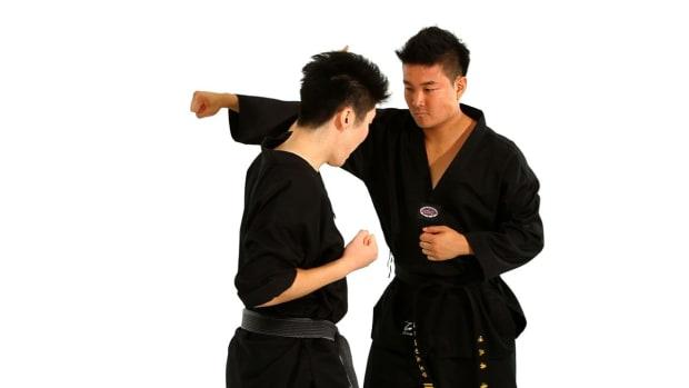 ZR. How to Do the Outside Block Taekwondo Technique Promo Image