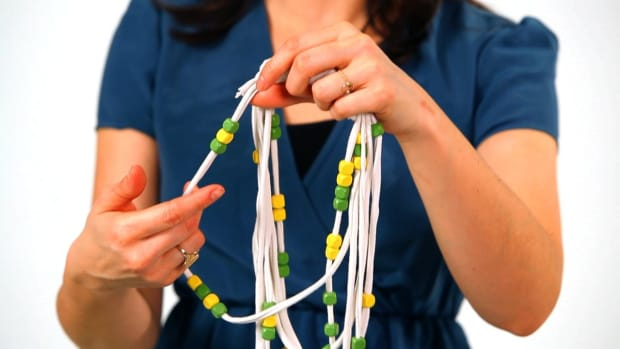 D. How to Add Beads to a No-Sew T-Shirt Necklace Promo Image
