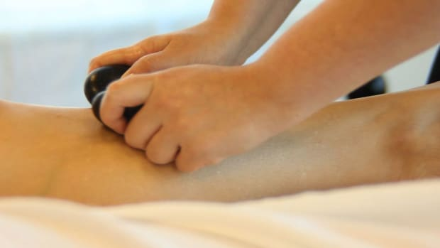 R. How to Place Hot Stones for a Front Leg Massage Promo Image