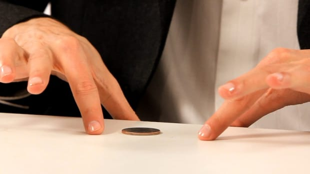 E. How to Do the Coin through a Table Trick Promo Image