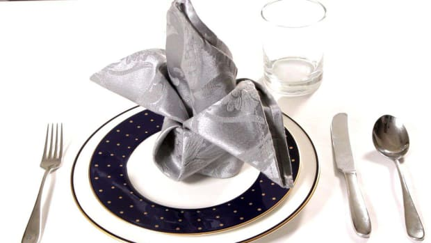 ZI. How to Fold a Napkin into a Crown Promo Image