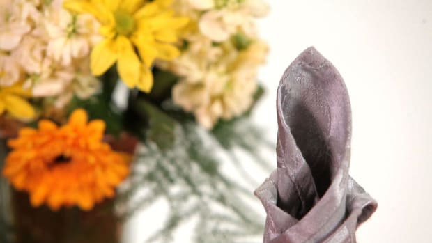 Y. How to Fold a Napkin into a Candle Promo Image