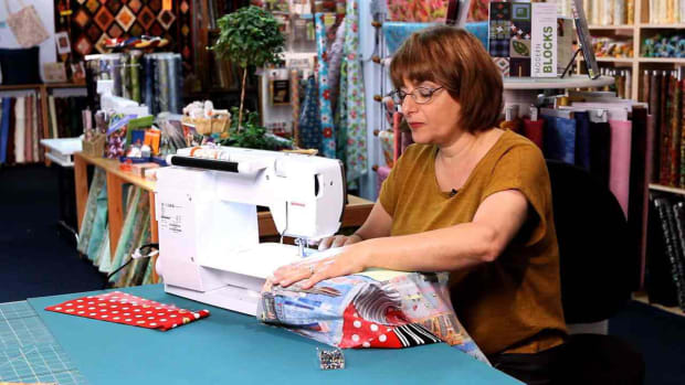 ZF. Pros & Cons of Machine Quilting vs. Hand Quilting Promo Image