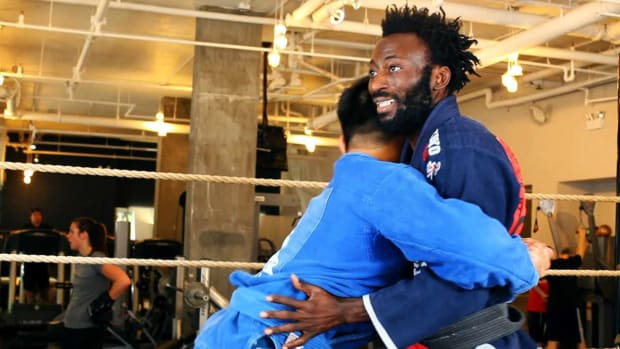 H. How to Get Out of a Front Bear Hug in Brazilian Jiu Jitsu Promo Image