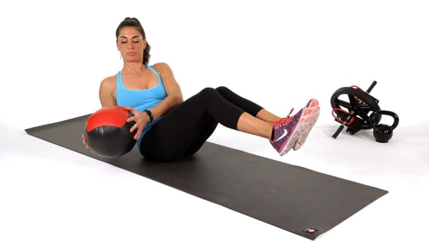 Y. How to Do Medicine Ball Side Twists or Rotations Promo Image