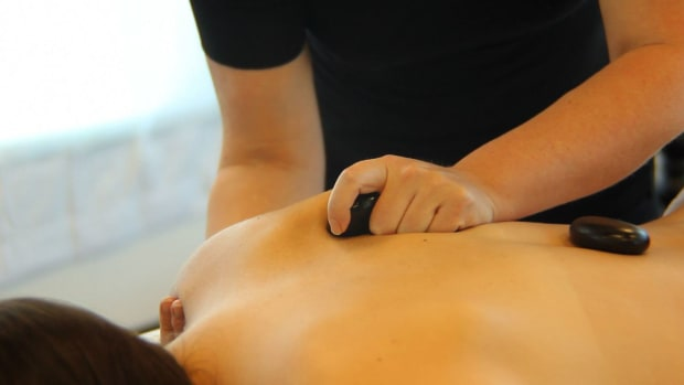U. How to Place Stones for a Back Massage Promo Image