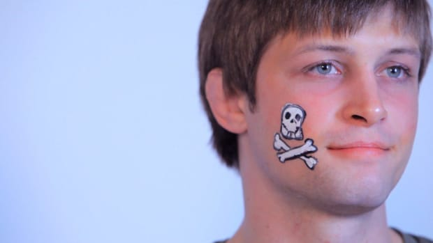 G. How to Paint a Cheek Skull with Face Paint Promo Image