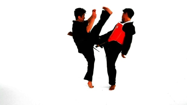 S. How to Do the Hop Step Roundhouse Kick Defense in Taekwondo Promo Image