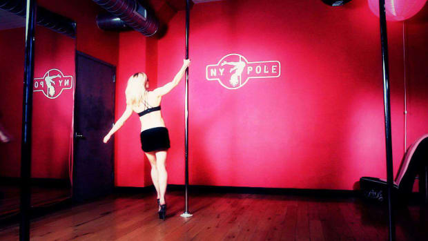 E. How to Do a Pole Dancing Spin & Invert Promo Image