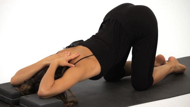 ZH. How to Do a Child's Pose (Balasana) in Yoga Promo Image