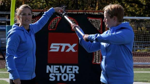 ZE. Triple Threat Position in Women's Lacrosse Promo Image