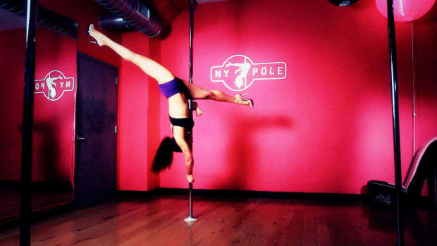 ZG. How to Do a Elbow Handstand Split in Pole Dancing Promo Image