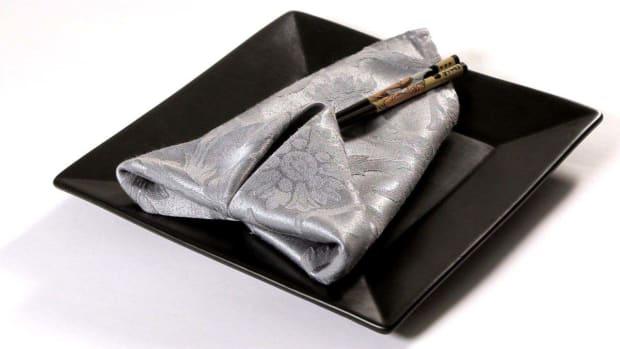 H. How to Fold a Napkin into a Double Diamond Promo Image
